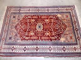 thin pile copper rust wool area rug