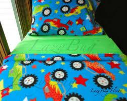 monster trucks on blue boys toddler bedding fleece bed set fits crib and toddler beds
