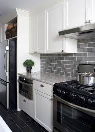 35 ways to use subway tiles in the kitchen digsdigsmodern white kitchen with grey subway tiles