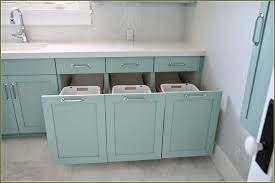 laundry furniture. Built-in-and-hidden-laundry-hamper-inside-cabinet- Laundry Furniture