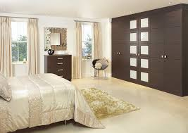 contemporary fitted bedroom furniture. Tobacco Pacific Walnut Wardrobe In A Pale Moon Coloured Bedroom Contemporary Fitted Furniture