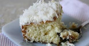 coconut cream poke cake uses cream of coconut and sweetened condensed milk to make it
