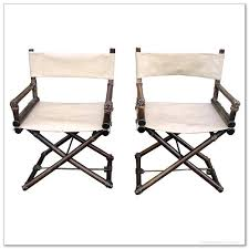 a pair of white leather director chairs with dark finished bamboos