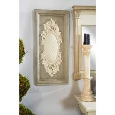 beige antique carved wood wall art