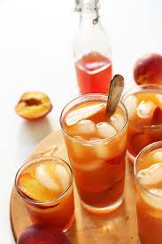 gles of summery peach iced tea
