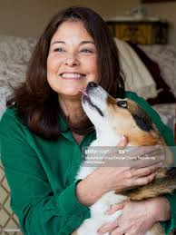 Priscilla Willis and her Welsh corgi, Tank, at their Huntington Beach...  News Photo - Getty Images