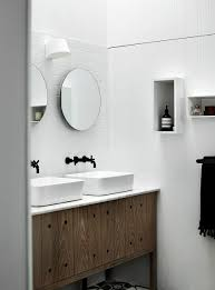 Compact bathroom vanity in wood with stone top and twin sinks ...