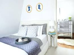 world market headboard bedding transitional bedroom and blue white faux fur rug gilt frames mirrored furniture