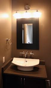 powder room bathroom lighting ideas. ideas dazzling designer powder room vanities with white ceramic vessel sink on black painted cabinets including bathroom lighting b