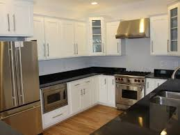Kitchen Black Appliances With White Cabinets