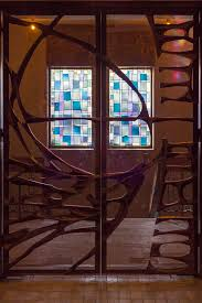modern stained glass window and a glass door at the oratoire saint joseph du mont