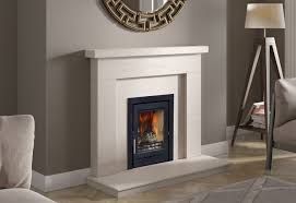 lime stone fireplace and inset woodburning stove