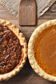 High Angle Vertical Of Half Of A Pecan Pie And A Pumpkin Pie