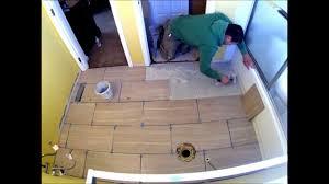 Porcelain Tile Staggered Bathroom Floor Installation Time Lapse - Installing bathroom tile floor