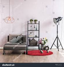 modern living room black and red. Modern Living Room Corner Sofa Behind Stone Soft Wall And Black Lamp With Red Carpet, R