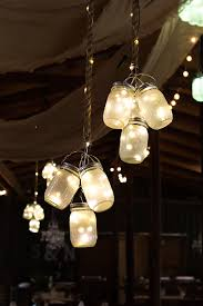 groups of led lights are contained within frosted mason jars which cut down on any harsh glare and create a firefly effect within the jar