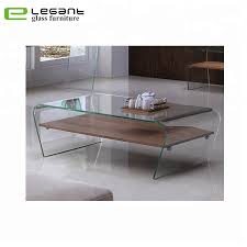 clear bent glass coffee table with wood