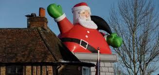 Blow-ho-ho: Giant inflatable Santa rips tiles off pub roof
