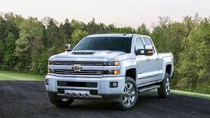 Chevrolet and GMC slap hood scoops on heavy duty trucks.