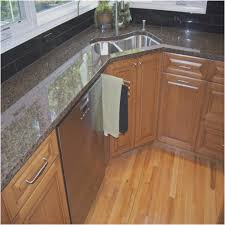 walnut wood sage green glass panel door corner kitchen sink base cabinet backsplash cut tile granite