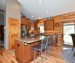 honed granite tops brick set tile splash lvt flooring stainless appliances recessed led lighting as well as signature hardware pendants