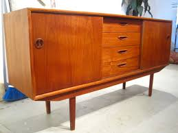 im absolutely obsessed with mid century modern danish teak furniture especially the credenza i really havent found a more perfect place to host a tv in beautiful mid century modern danish style teak