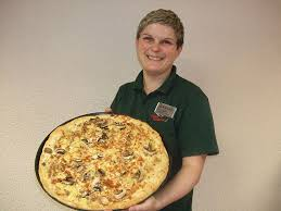3 pizza gallerie man showing pizza jpg