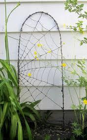 beautiful barbed wire spider web garden