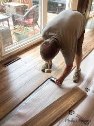 these step by step instructions on how to install laminate flooring include tips and tricks on
