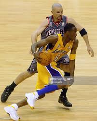Kobe Bryant of the Los Angeles Lakers is guarded by Jason Kidd of ...