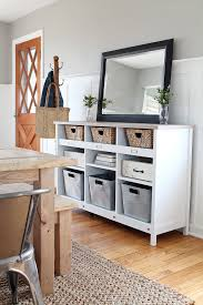 A simple storage credenza turns into functional entryway storage AND a  dining room buffet. See