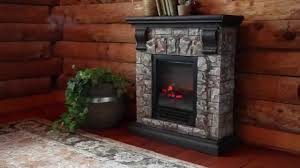 small stone framed electric fireplace with black finished wood mantel