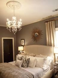 beautiful bedroom design with gray walls paint color crystal chandelier black door and mirrored nightstands