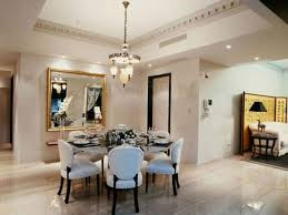 shining ceramic floor for luxury dining room ideas with small chandelier and comfortable white chairs using rustic wooden round dining table
