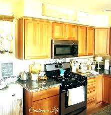 kitchen cabinet decorating ideas above kitchen cabinet decorations top of decor ideas greenery cabinets um size door decorating decoration oak kitchen