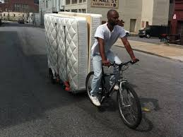 hauling two mattresses on a 64aw bicycle trailer