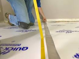 covering the floor with underlayment
