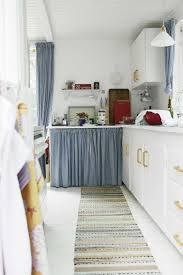 Long Curtains In Kitchen Minimalist Modern Kitchen Design With Long Striped Rug And White