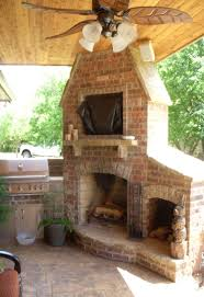 outdoor fireplace and grill w that s an awesome corner fireplace spot for firewood