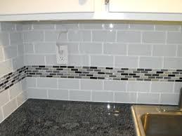 black glass mosaic tile backsplash light grey subway white grout with  decorative line of mosaic astounding