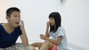 asian boy and girl picking their nose during playing together hd stock clip