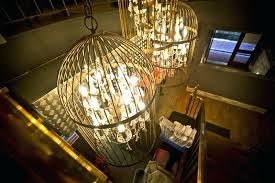 cork chandelier dramatic lighting in the form of large birdcage chandeliers and to set the right