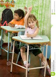 student sitting at desk hands folded. Brilliant Sitting Two Students Sitting At Desks In A Classroom They Have Their Hands Raised  Vertically Framed Shot On Student Sitting At Desk Hands Folded N