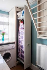 Fold down airer a good idea, ironing board storage too - though could have  built in ironing board especially if open plan but divided