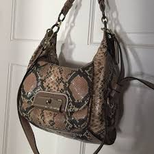Coach Hobo style shoulder bag Small hobo style shoulder bag. Light brown  snake print. One large pocket with 3 interior pockets. Front flap pocket.