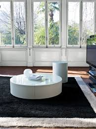 ... White Modern Round Coffee Table With End Table In Nice Living Room