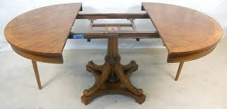 walnut round extending dining table round walnut extending dining table to seat ten sold 2 p walnut round extending dining table
