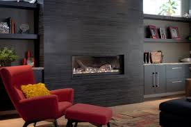 modern designed living room with large black stone tile fireplace