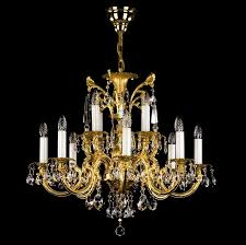 brass chandelier in size of 84 x 67 cm with 12 light sources is decorated with classic crystal exclusive or swarovski spectra crystal ts