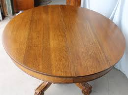 antique round oak dining table 45 inches diameter with three leaves